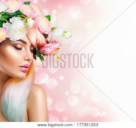 Spring Woman. Beauty Summer model girl with colorful flowers wreath, hair and makeup. Flowers Hair Style. Beautiful Lady with Blooming flowers on her head. Nature Hairstyle. Holiday Fashion Makeup