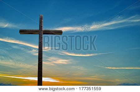 Old wooden cross on blue sky background concept of religion
