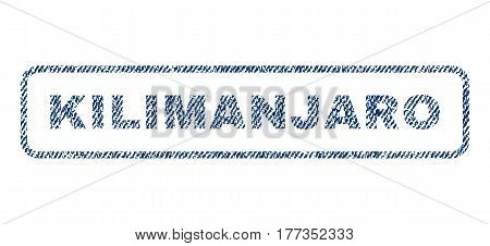 Kilimanjaro text textile seal stamp watermark. Blue jeans fabric vectorized texture. Vector caption inside rounded rectangular banner. Rubber sign with fiber textile structure.