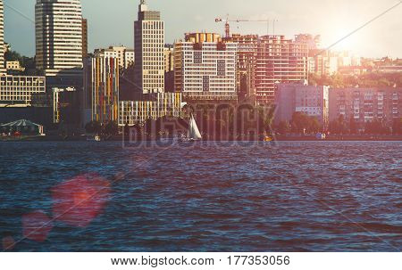 Quay of the big city at sunset, the river Dnepr, Dnepropetrovsk, blue toning, background