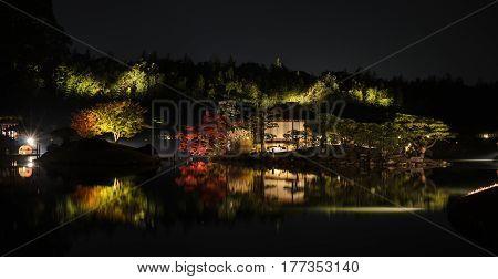 Stunning night illumniation autumn color of Korakuen Japanese garden in Okayama, Japan