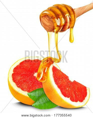 dripping honey on the grapefruit slices isolated on white