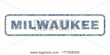 Milwaukee text textile seal stamp watermark. Blue jeans fabric vectorized texture. Vector tag inside rounded rectangular banner. Rubber sign with fiber textile structure.