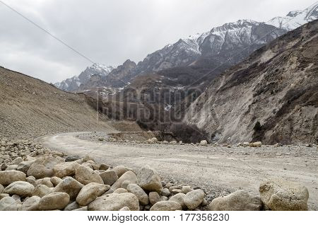 A winding dirt road in the mountains