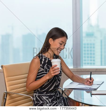 Business woman writing paperwork at desk. Businesswoman, lawyer or accountant doing contract work in home office.