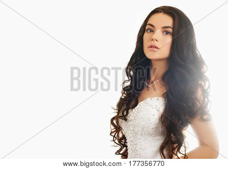 Fashion Model Bride With Long Flowing Brunette Hair And Wedding Makeup. Wavy Hair. Portrait Of A Bea