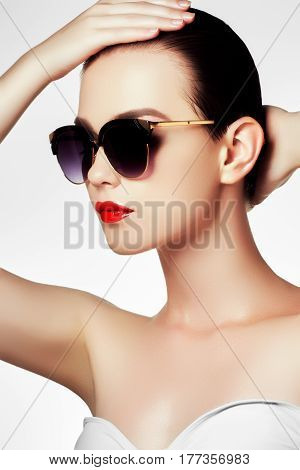 Fashion Sunglasses. Sexy Woman In Swimsuit With Golden Sunglasses And Fashion Makeup. Glamour Shot O
