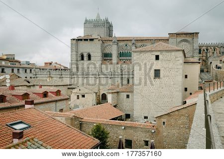 Avila Spain - November 11 2014: The Medieval Walls of Avila and the Cathedral. The old city and its extramural churches were declared a World Heritage site by UNESCO