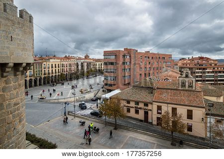 Avila Spain - November 11 2014: Scenic view of Avila cityscape from the Medieval Walls. The old city and its extramural churches were declared a World Heritage site by UNESCO