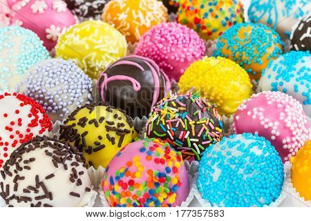 Different Colorful Cake Balls With Decorative Sprinkles