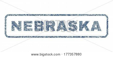 Nebraska text textile seal stamp watermark. Blue jeans fabric vectorized texture. Vector caption inside rounded rectangular shape. Rubber sticker with fiber textile structure.