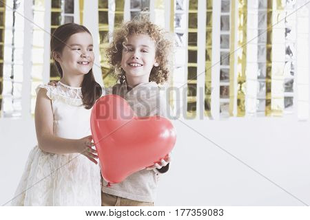 Boy And Girl Holding Heart