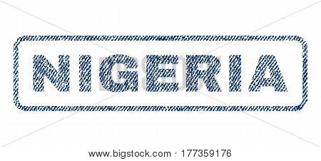 Nigeria text textile seal stamp watermark. Blue jeans fabric vectorized texture. Vector caption inside rounded rectangular shape. Rubber emblem with fiber textile structure.