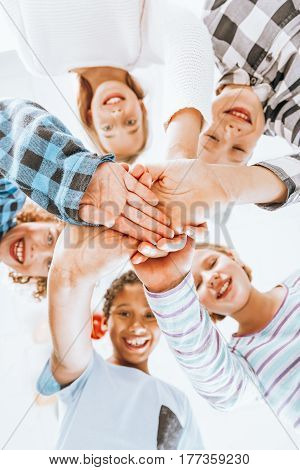 Children Keeping Their Hands Piled