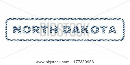 North Dakota text textile seal stamp watermark. Blue jeans fabric vectorized texture. Vector tag inside rounded rectangular shape. Rubber sticker with fiber textile structure.