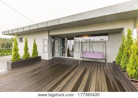 Spacious Terrace With Garden Porch Swing