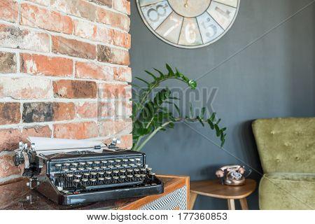 Typewriter Against Brick Wall