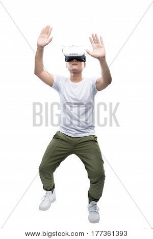 Happy young asian man using the virtual reality headset isolated on white with copy space