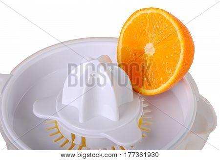 Juicer and an orange half close up