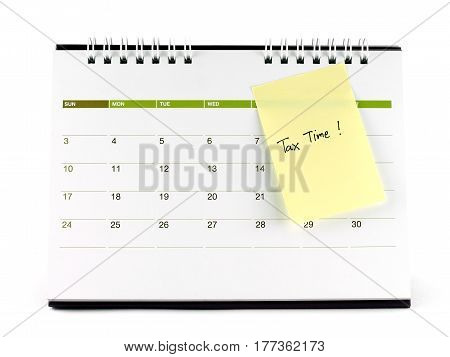 Tax Time written on yellow paper note taped on calendar page isolated on white background, ideas & concept about reminder for tax time