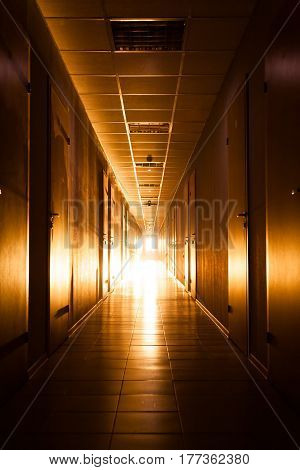 Corridor with warm light at the end
