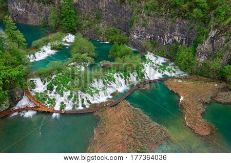 Cascades near the tourist path in Plitvice lakes national park in Croatia