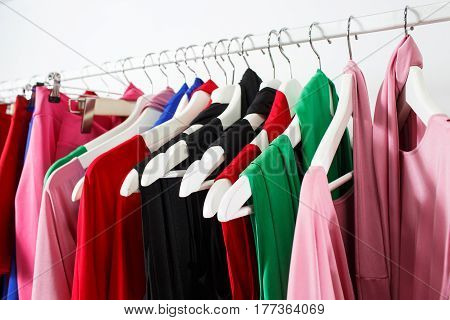 Clothing on hanger at the modern shop boutique.