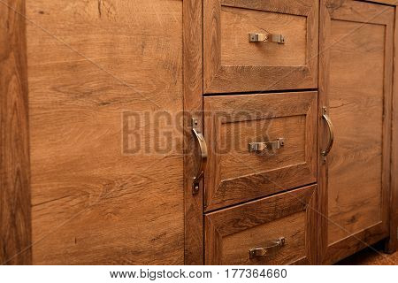 Close-up Detail Of High Quality Oak Wood Cabinets With Bronze Cabinet Hardware Drawer Pulls