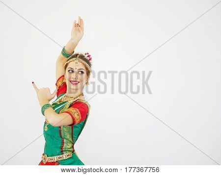 Beautiful Indian dancer on a white background. Culture and traditions of India.