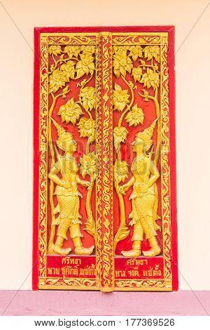 Thai door temple , angel on door