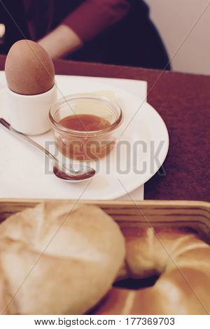 Austrain breakfast with boiled egg and fresh bread rolls