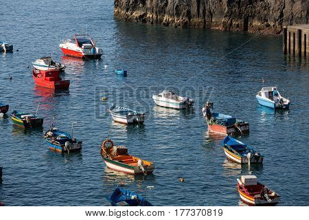 CAMARA DE LOBOS MADEIRA PORTUGAL - SEPTEMBER 5 2016: Fishing boats in Camara de Lobos Madeira Islands Portugal