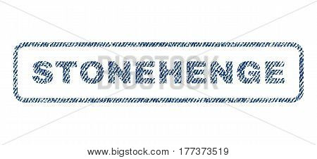 Stonehenge text textile seal stamp watermark. Blue jeans fabric vectorized texture. Vector caption inside rounded rectangular shape. Rubber emblem with fiber textile structure.