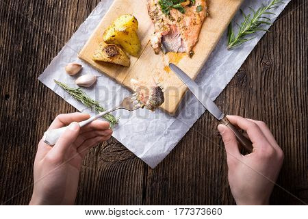 Trout With Potateos On Wooden Board.