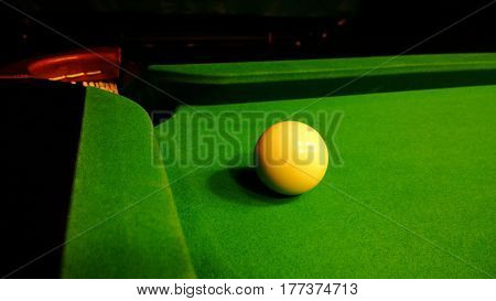 The cue ball close to the pocket