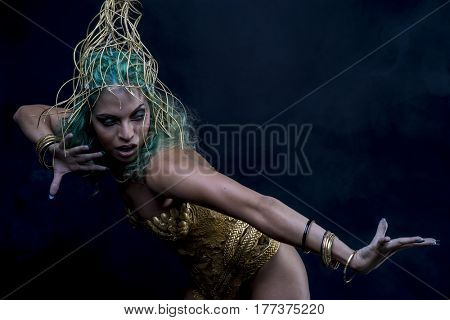 Golden Latin woman with green hair and gold costume with handmade flourishes, fantasy image and tale
