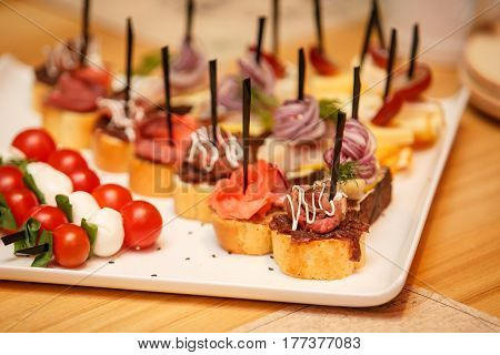 catering banquet table with different food snack on event