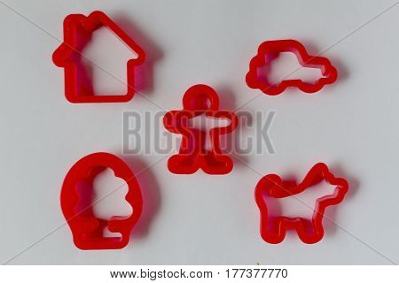 set of molds for plasticine. Toy pie mould on  white  background. icons in the form of man, house, dog, car and tree.