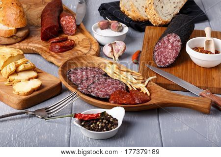 Snack set. Variety of salami cheese chechil and bread. Rustic style.