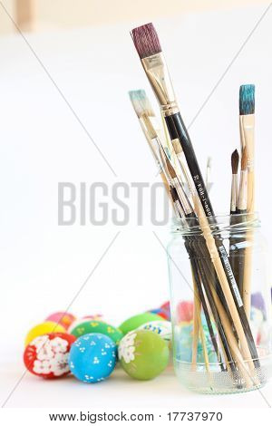 Brushes and painted eggs