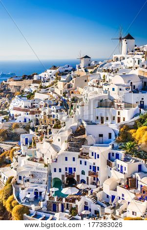 Santorini Greece. Oia city with white and blue houses in Aegean Sea. Thira Cyclades Islands.