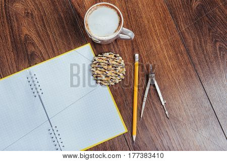 Top View Of Notebook, Stationery, Drawing Tools And A Few Cups Coffee.