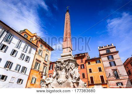 Rome Italy. Night scene with Egyptian Obelisk in Rotonda Square heart of Italian capital city.