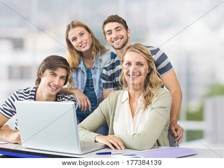 Digital composite of Group of people using laptop and smiling against a light background