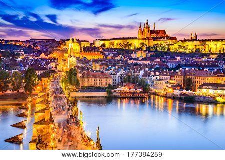 Prague Czech Republic. Charles Bridge and Hradcany (Prague Castle) with St. Vitus Cathedral and St. George church evening dusk Bohemia landmark in Praha.