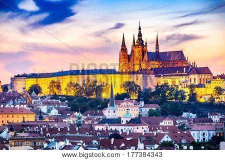 Prague Czech Republic. Hradcany (Prague Castle) with St. Vitus Cathedral and St. George church evening dusk Bohemia landmark in Praha.