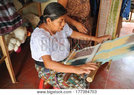 San Juan la laguna, Guatemala - 12 February 2014: Mayan woman weaving yarns at San Juan la laguna on Guatemala