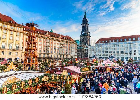 DRESDEN SAXONY / GERMANY - 17 DECEMBER 2016: People visit Christmas Market Striezelmarkt in Dresden Germany. Christmas fair European traditions.