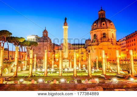 Rome Italy. The church Most Holy Name of Mary and the Roman Triumphal Column at twilight on Trajan Forum.