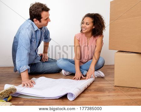 Young interracial couple ready for home relocation